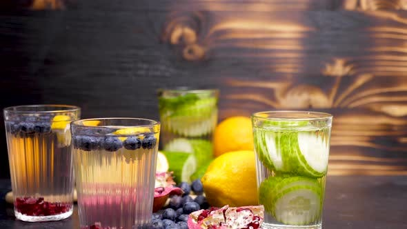 Thumbnail for Homemade Lemonade Made of Different Fruits and Berried and Glasses with Detox Cucumber Water