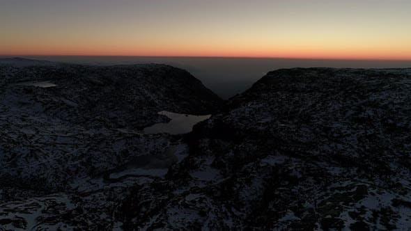 Thumbnail for Bird's-eye View of the Snowy Mountain Lake