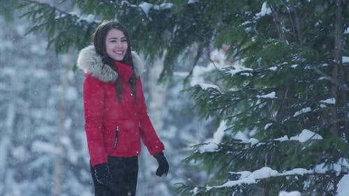 Girl smiling on a snowy day