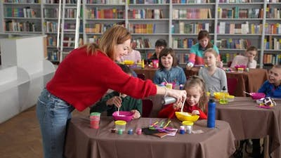 Teacher Making Slime with Students
