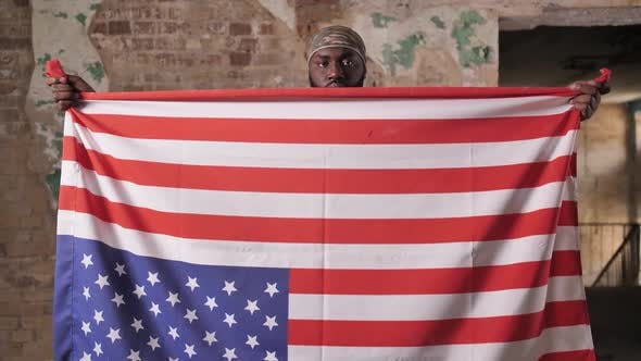 Thumbnail for Black Soldier with US Flag Upside Down in Protest