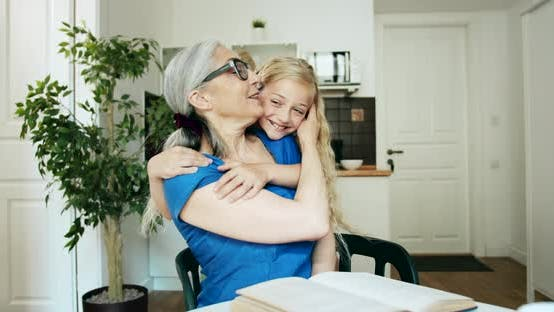 Thumbnail for Grandmother and Granddaughter Hugging