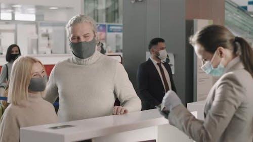 Couple Passing Passport Control In Airport