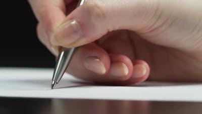 Close up of pen writing