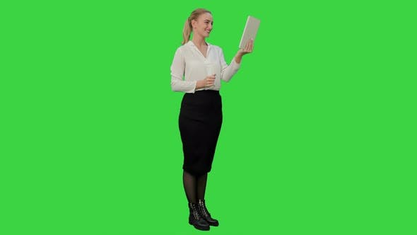 Thumbnail for Young Businesswoman Have a Video Chat on Tablet Computer on a Green Screen, Chroma Key