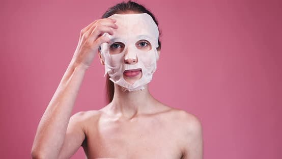 Thumbnail for Young Woman Removing Facial Mask