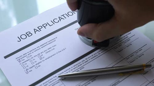 Job Application Document Approved Hand Stamping Seal on Official Paper Hiring