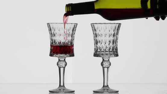 Rose Wine. Red Wine Pour in Two Wine Glasses Over White Background