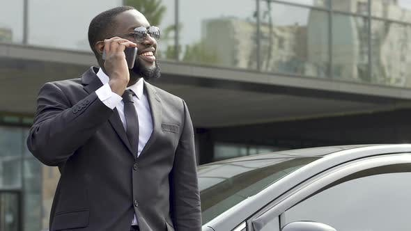 Cover Image for Business Lawyer Talking Over Phone and Smiling, Celebrating Successful Case