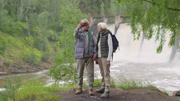 Thumbnail for Happy Elderly People Taking Selfie at Spillway