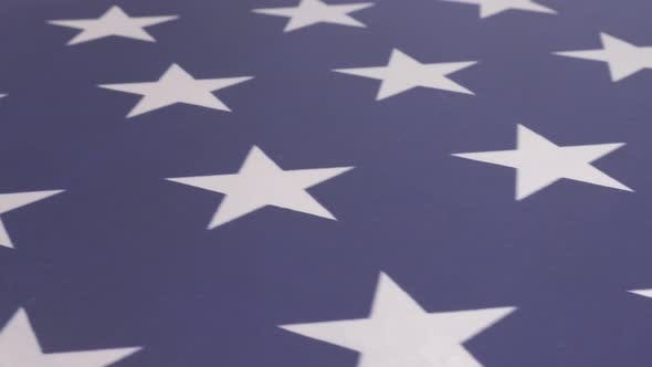Thumbnail for Fabric of American flag shoot with dolly  close-up 4K 2160p UHD video - USA flag stars and bars slow
