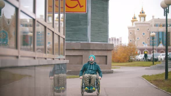 "Thumbnail for Disabled Man in Wheelchair Sees the ""Disabled"" Sign and Moving Towards the Special Place"