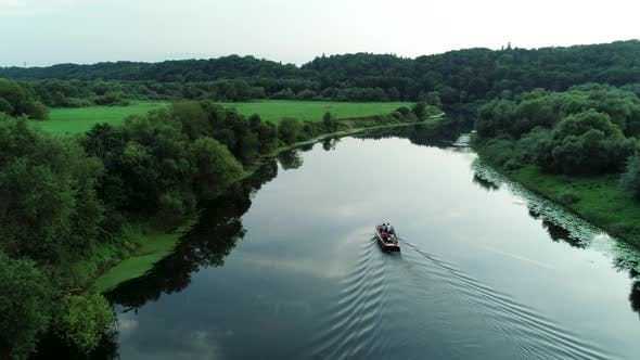 Thumbnail for Aerial View Of Boat Sailing In Jungle River
