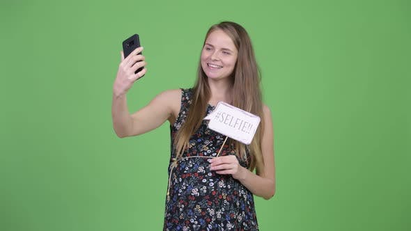 Thumbnail for Young Happy Pregnant Woman Taking Selfie with Paper Sign