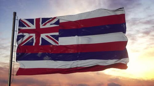 Flag of Hawaii Waving in the Wind Against Deep Beautiful Sky at Sunset