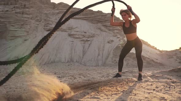 Thumbnail for Female Athlete Training Outdoors Around the Sand Hills at Sunset. Active Physical Activity Workout