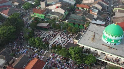 Aerial View of People offering prayers on the Eid morning at famous mosque Jama Masjid in Bekasi.