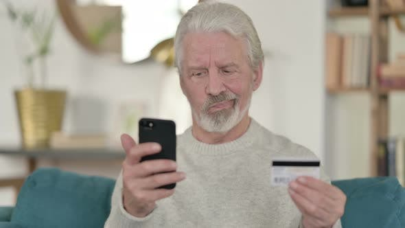 Thumbnail for Old Man Reacting To Online Payment Failure on Smartphone