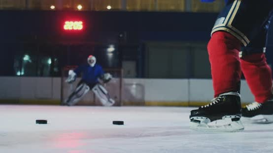 Cover Image for Close-up of a Hockey Puck in Slow Motion and a Putter of Several Pucks in Turn and a Goalkeeper
