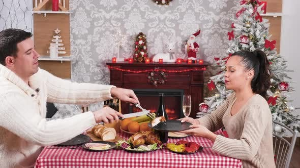 Thumbnail for Caucasian Couple Enjoying a Christmas Dinner and Clinking Glasses with Champagne