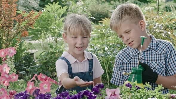 Thumbnail for Boy Teaching Sister Gardening