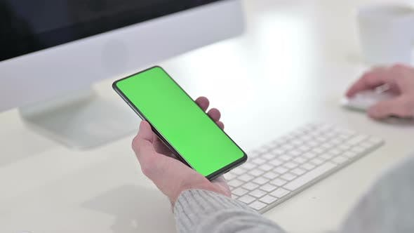 Thumbnail for Close Up of Using Smartphone with Green Mock-up Screen