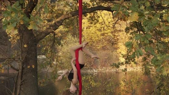 Aerial Gymnastics Woman Performs Acrobatic Tricks On An Air Hoop At Sunrise