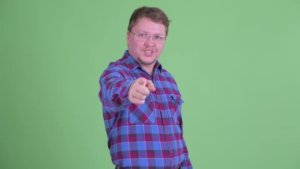 Thumbnail for Happy Overweight Bearded Hipster Man Pointing at Camera