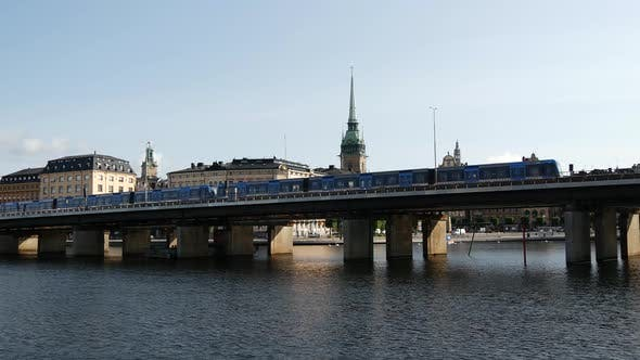 Thumbnail for Metro passing by with Gamla stan islands in the background