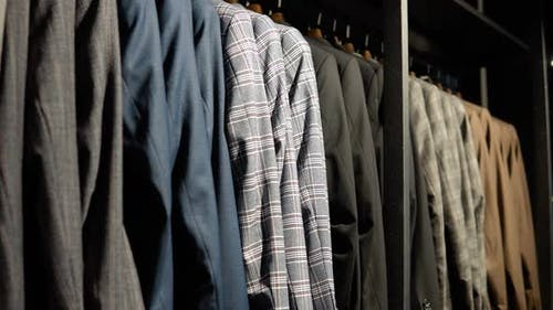 Showcase with Jackets From the New Collection in the Luxury Boutique of Men's Suits