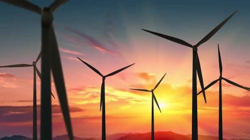 Wind Turbines Farm at Beautiful Orange Sunset. Ecologic Energy Generators on Beautiful Sunny