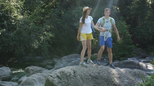 Thumbnail for Cheerful Couple of Hikes Enjoying Panaromic View