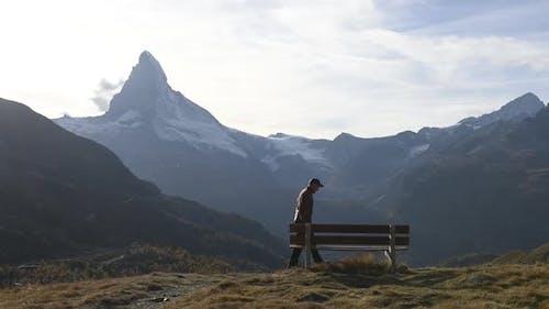 Picturesque View of Matterhorn Peak and Wooden Bench in Swiss Alps