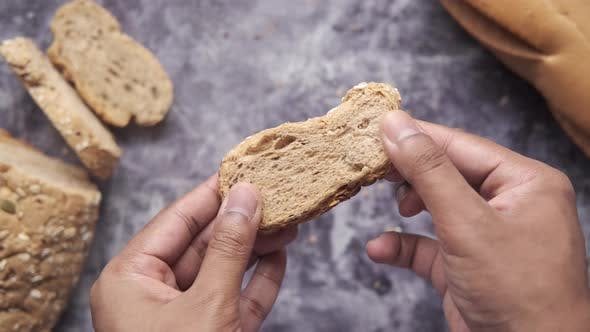 Holding Slice of Baked Bread Close Up