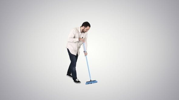 Thumbnail for Young Man Cleaning Floor with Brush on Gradient Background