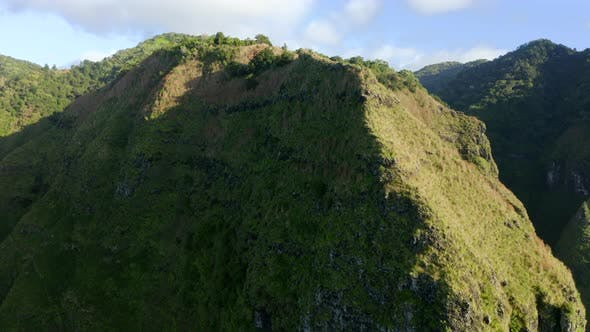 Thumbnail for Beautiful Aerial Footage of the Grassy Top of the Mountain Under the Bright Sun