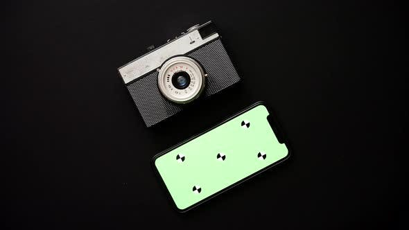 Thumbnail for Old Retro Film Camera and Modern Smartphone on Black Background