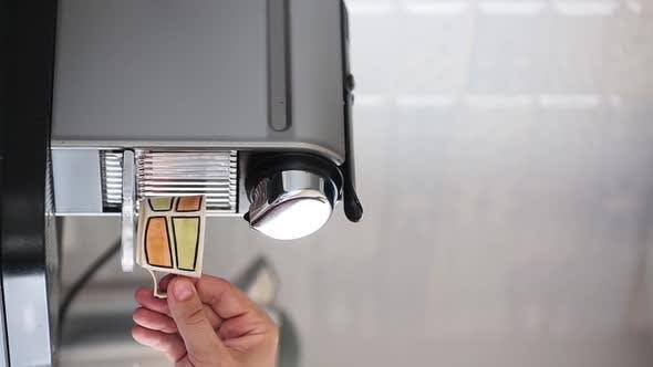 Vertical Video - View of a Home Coffee Macine Preparing Coffee.