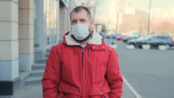 Thumbnail for Young Hipster Bearded Man Wearing Protective Mask on Street Background. Health and Safety Life, N1H1