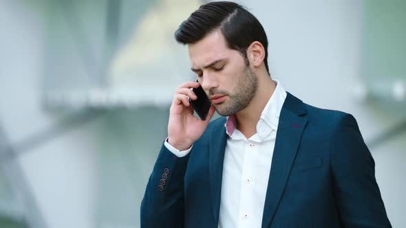 Thumbnail for Portrait Businessman Talking Smartphone. Man Having Business Phone Talk