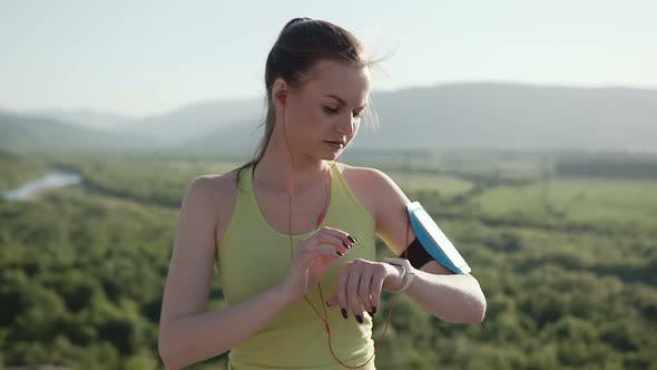Cover Image for Young Sports Girl in Sports Wear Who Runs in the Fresh Air in the Mountains