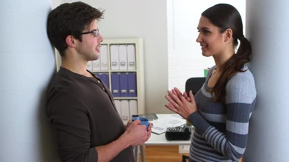 Thumbnail for Business partners casually talking in office