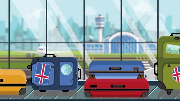 Suitcases with Icelandic Flag Stickers on Baggage Carousel