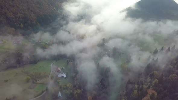 Thumbnail for Aerial View of Foggy Morning in Autumn Rural Country at Sunrise