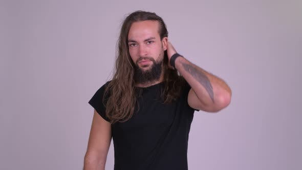 Thumbnail for Stressed Young Bearded Hipster Man with Long Hair Giving Thumbs Down