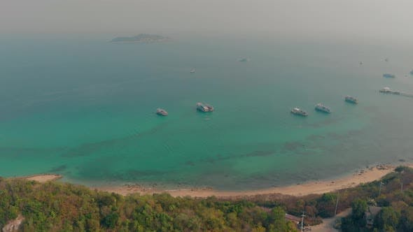 Thumbnail for Motorboats Drift on Calm Ocean Water at Beach Aerial View