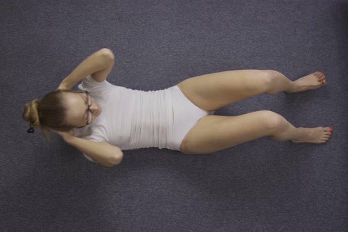 Sporty Woman Doing Crunches On The Floor At Home By Stusya On