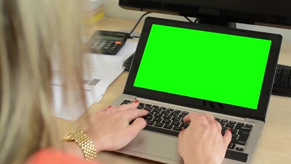 Thumbnail for Young Attractive Woman Working on the Laptop Computer in the Office - Green Screen