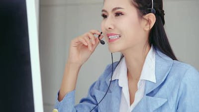 Customer Support Agent or Call Center with Headset Talking to Customer on Phone