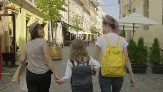 Thumbnail for Walking Traveling Mother and Daughters, Happy Positive Family